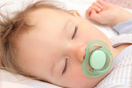 sleeping boy with pacifier