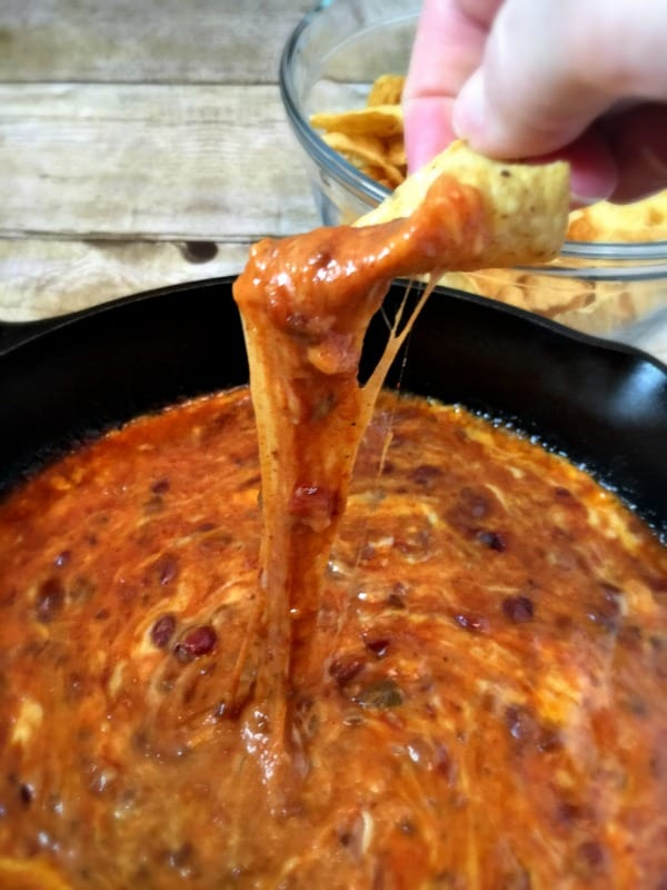 dipping in the chili cheese skillet dip