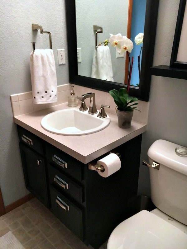 Half bathroom gets a new design with a fabulous black vanity