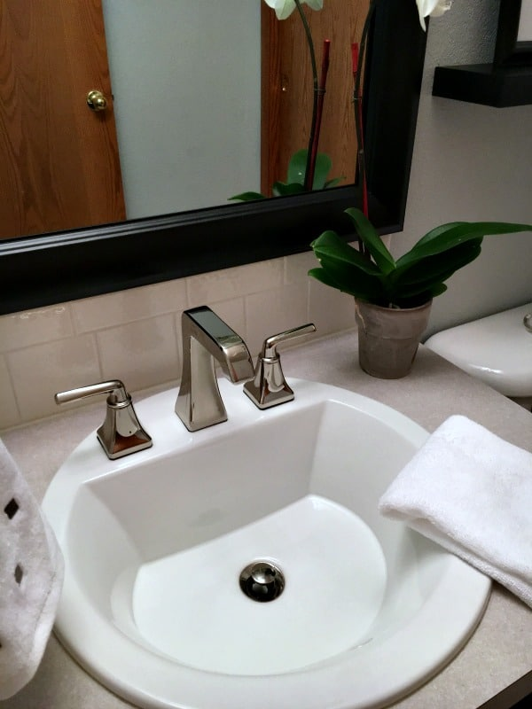 New faucet in remodeled half bathroom.