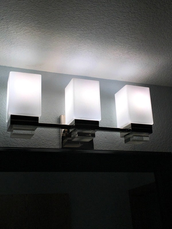 New lighting for half bathroom from Lamps Plus