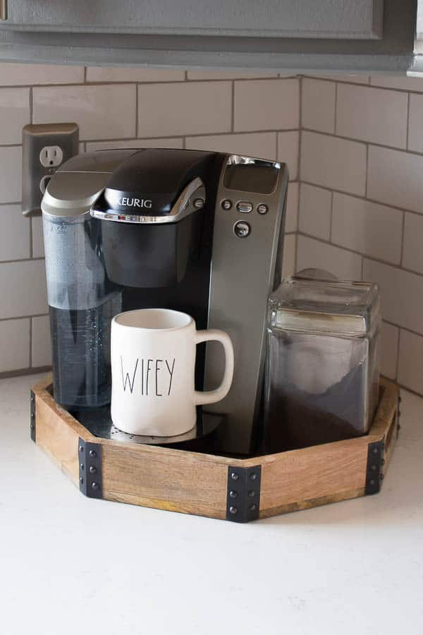 A builder grade kitchen gets a new look with classic features like gray cabinets, Quartz counters and subway tile. Cute coffee station!