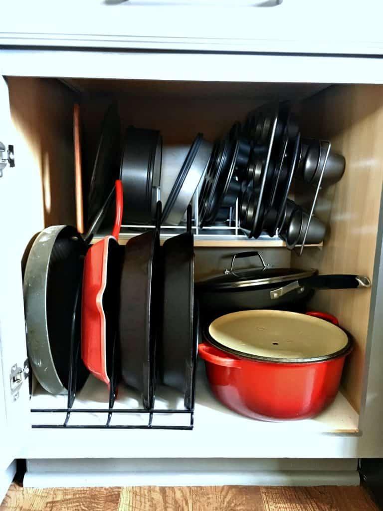 organize kitchen baking pans with pot organizer
