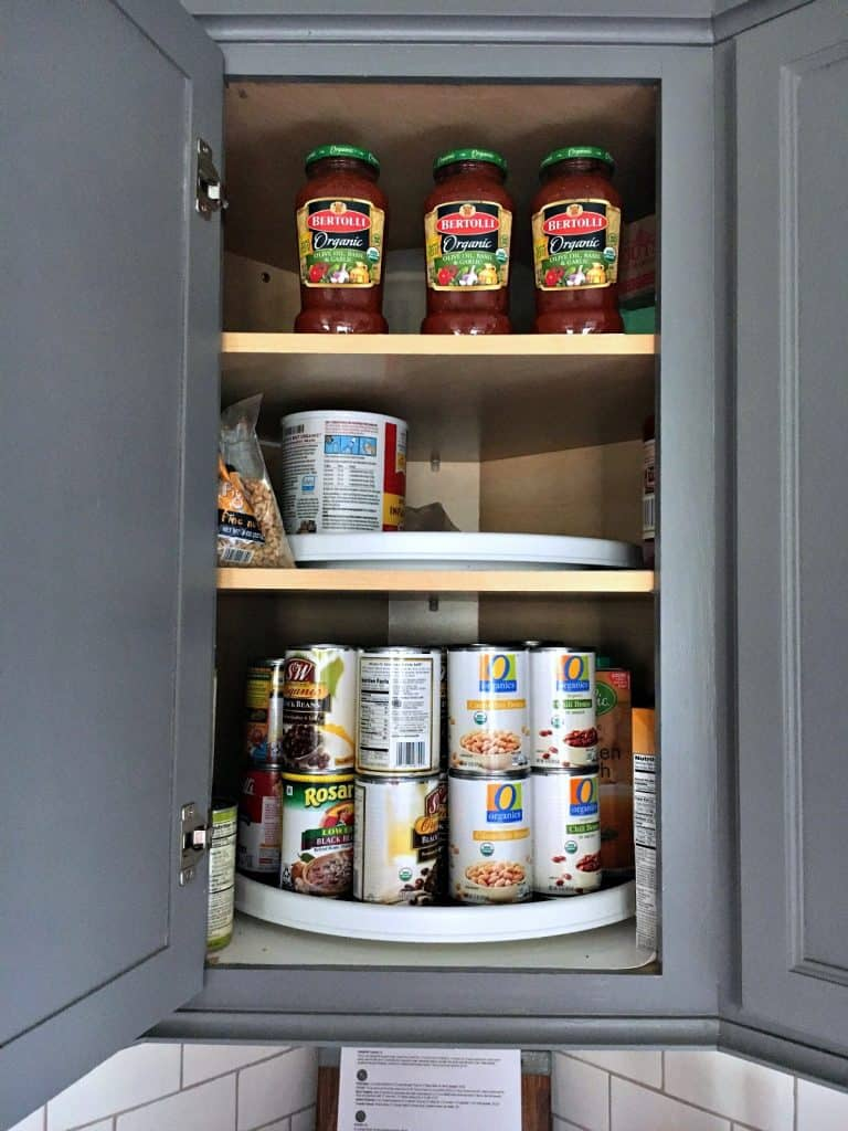 organize kitchen with lazy susans for canned goods