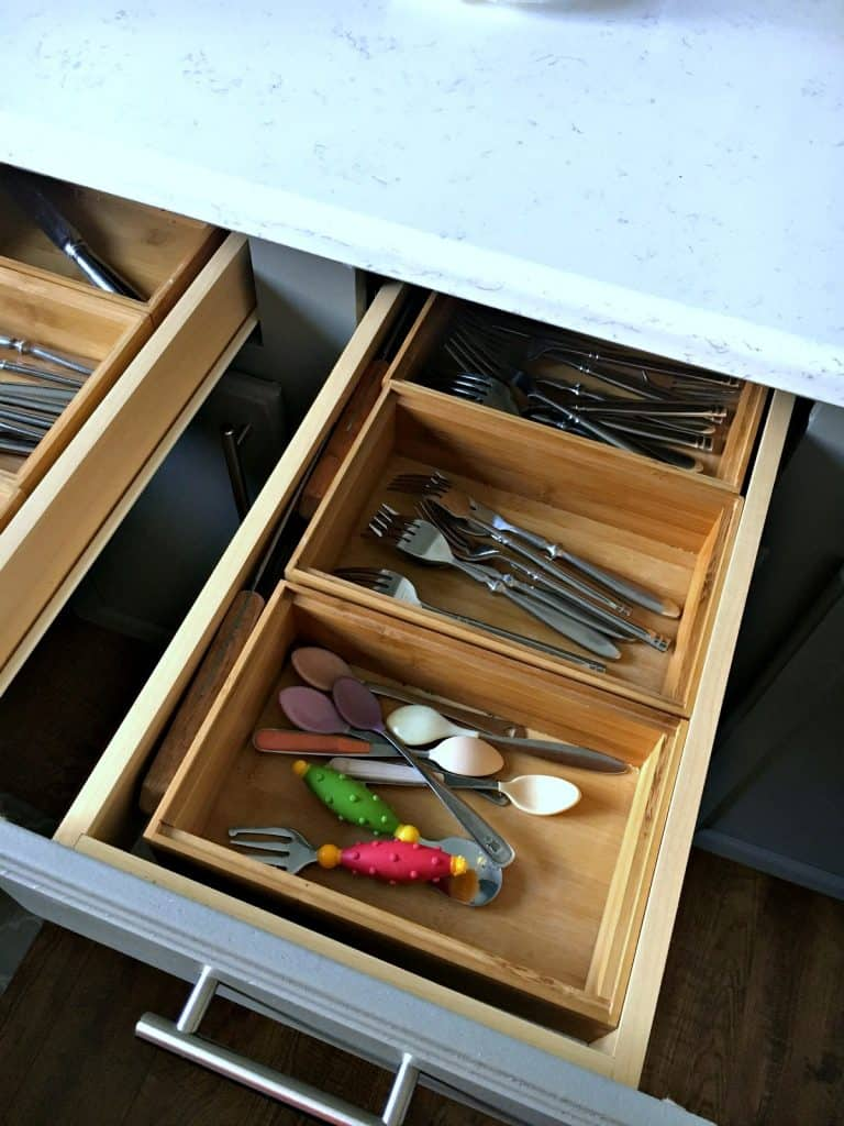Organize with bamboo trays for utensils