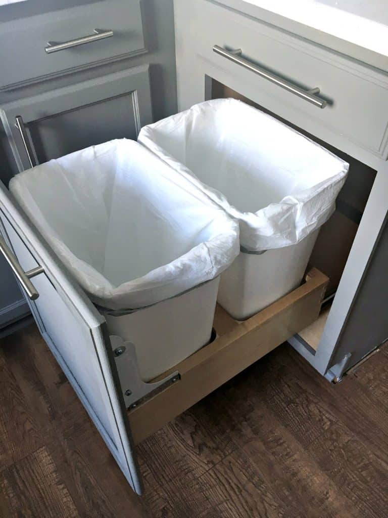organize with pull out trash and recycle bins