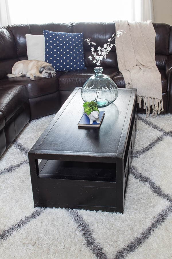Spring Home Tour - leather couch, navy pillow, vase