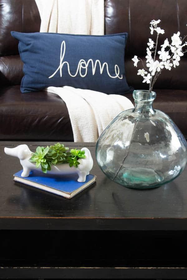 Spring Home Tour - navy home pillow, vase, living room