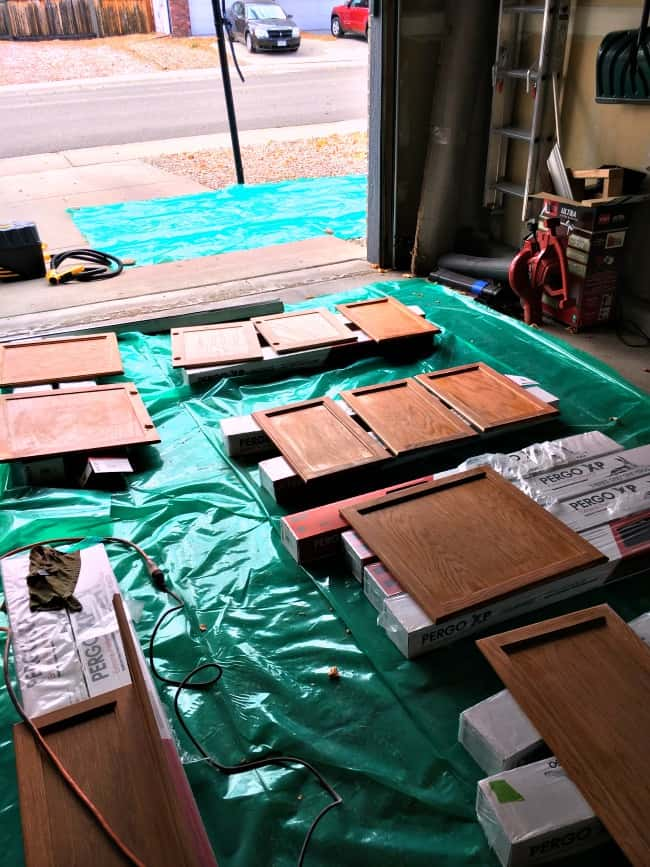 how to easily paint kitchen cabinets - lay all cabinet doors and drawers in garage