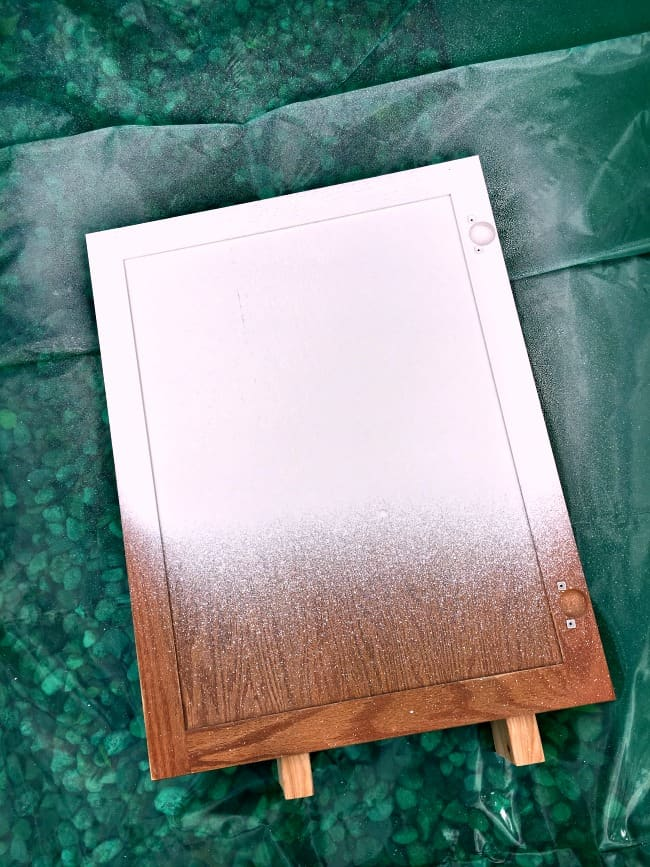 how to easily paint kitchen cabinets - kitchen cabinet door with first coat of primer
