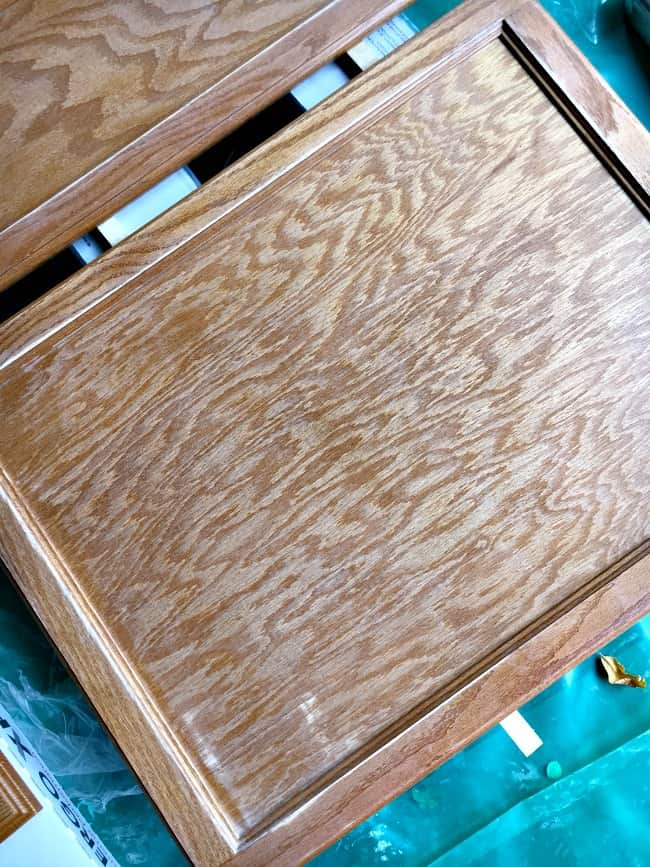 how to easily paint kitchen cabinets - sanded cabinet door