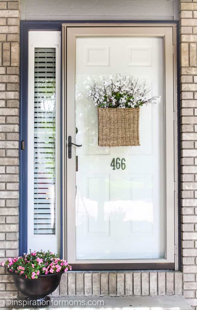 Simple Summer Home Tour at Inspiration for Moms with wall basket and planted flowers.