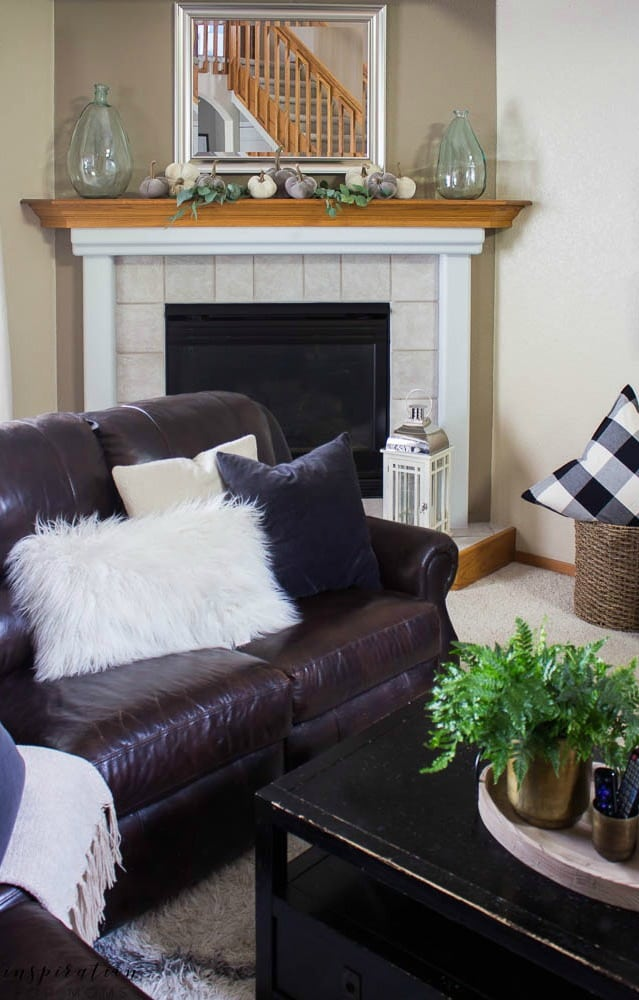 Welcome to a neutral Fall home tour with white pumpkins and plenty of cozy touches. fall living room, fireplace, buffalo check, velvet pumpkins