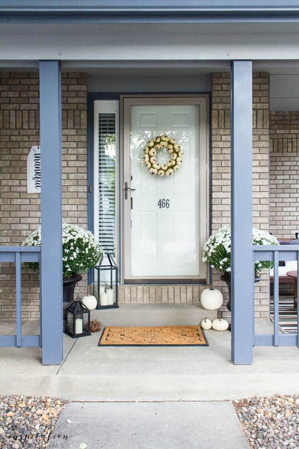 Welcome to a neutral Fall home tour with white pumpkins and plenty of cozy touches. fall front porch, white pumpkins, lanterns