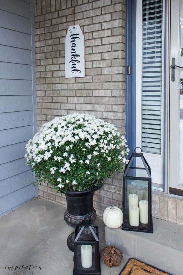 Welcome to a neutral Fall home tour with white pumpkins and plenty of cozy touches. white mums, black lanterns