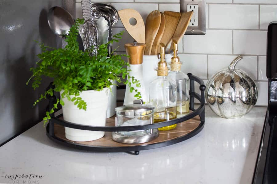 Welcome to my simple, but cozy Fall Home Tour -- white subway tile, modern wood tray, white canisters, oil bottles, utensil organization