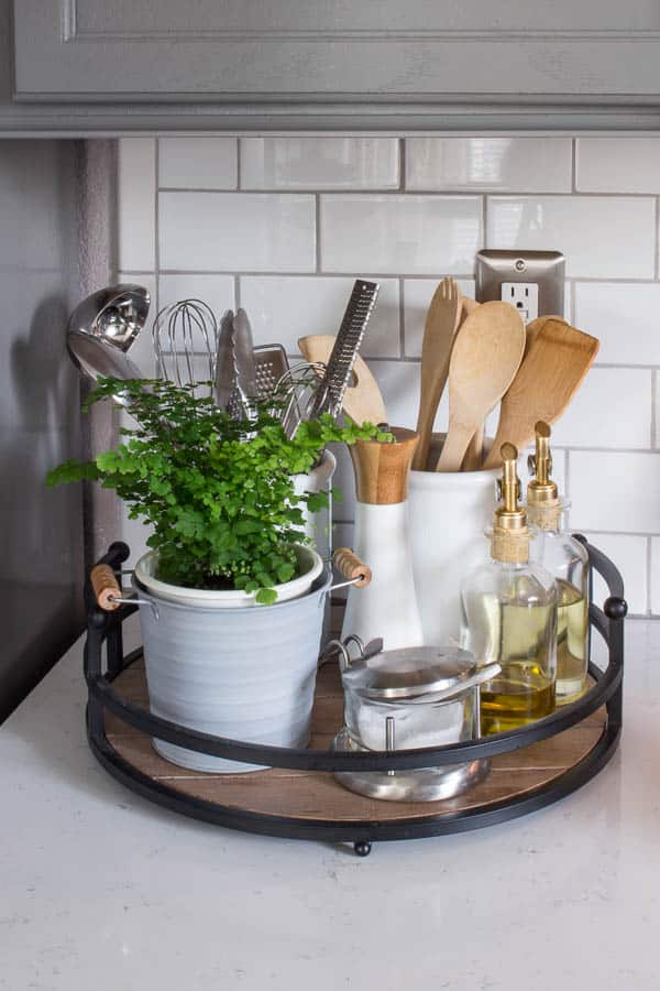 Keep kitchen utensils organized and within reach with a modern wood tray.