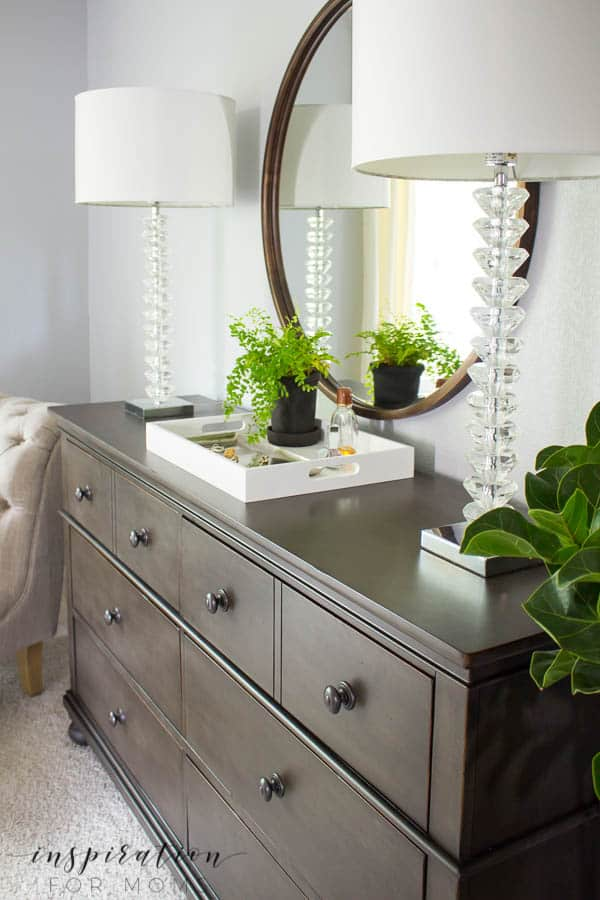 Organize bedroom essentials with a white tray.