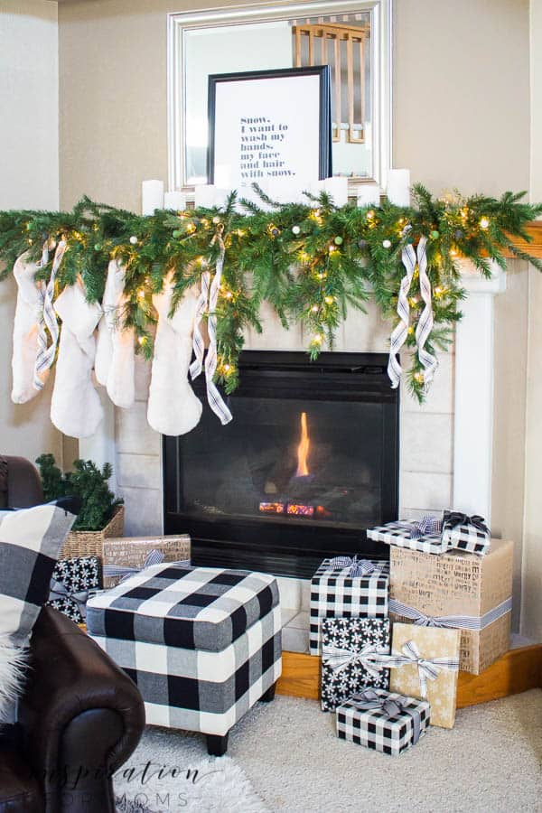 Nothing super fancy here...a simple, twinkling White Christmas Mantel is all I need.Come see how easy it is to decorate a mantel for Christmas.