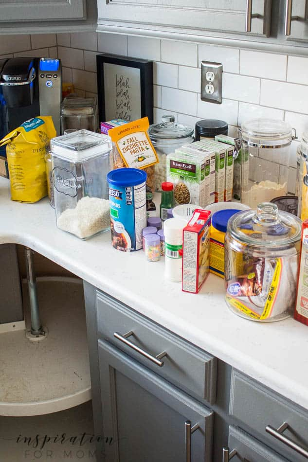 Does your cabinet lazy susan got you spinning? See how easy organizing the corner lazy susan can be!