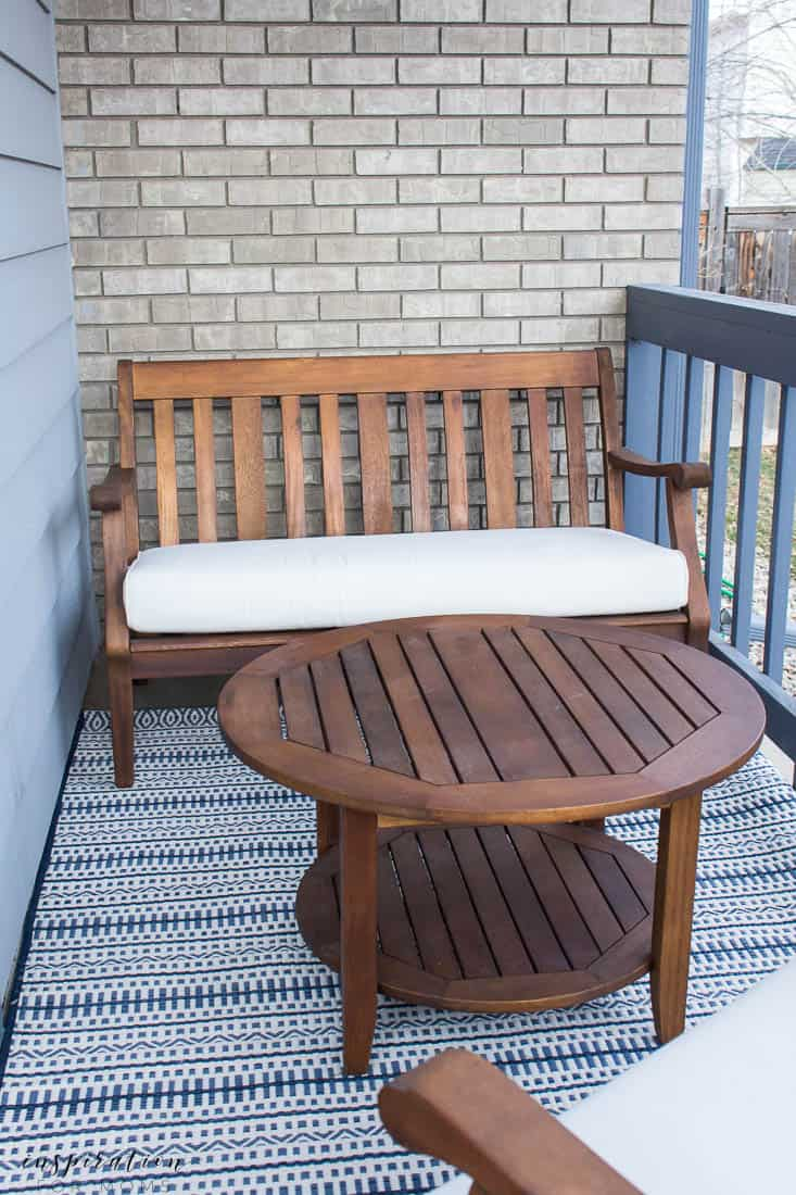 five easy tips to get your front porch spring ready navy striped rug lounge bench