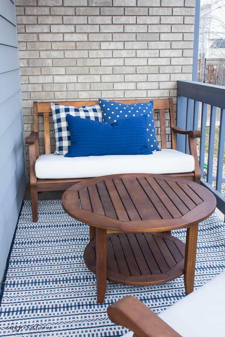 five easy tips to get your front porch spring ready buffalo check navy pillows striped navy outdoor rug