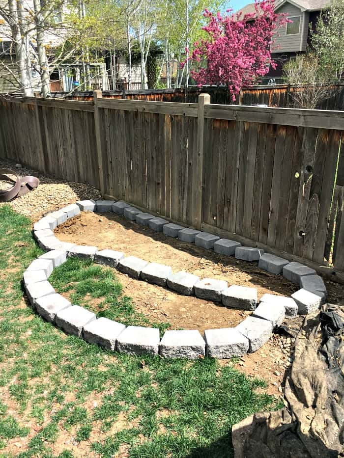 Learn how to build a raised garden with pavers that adds a fun architectural element to your yard with this simple step-by-step tutorial.
