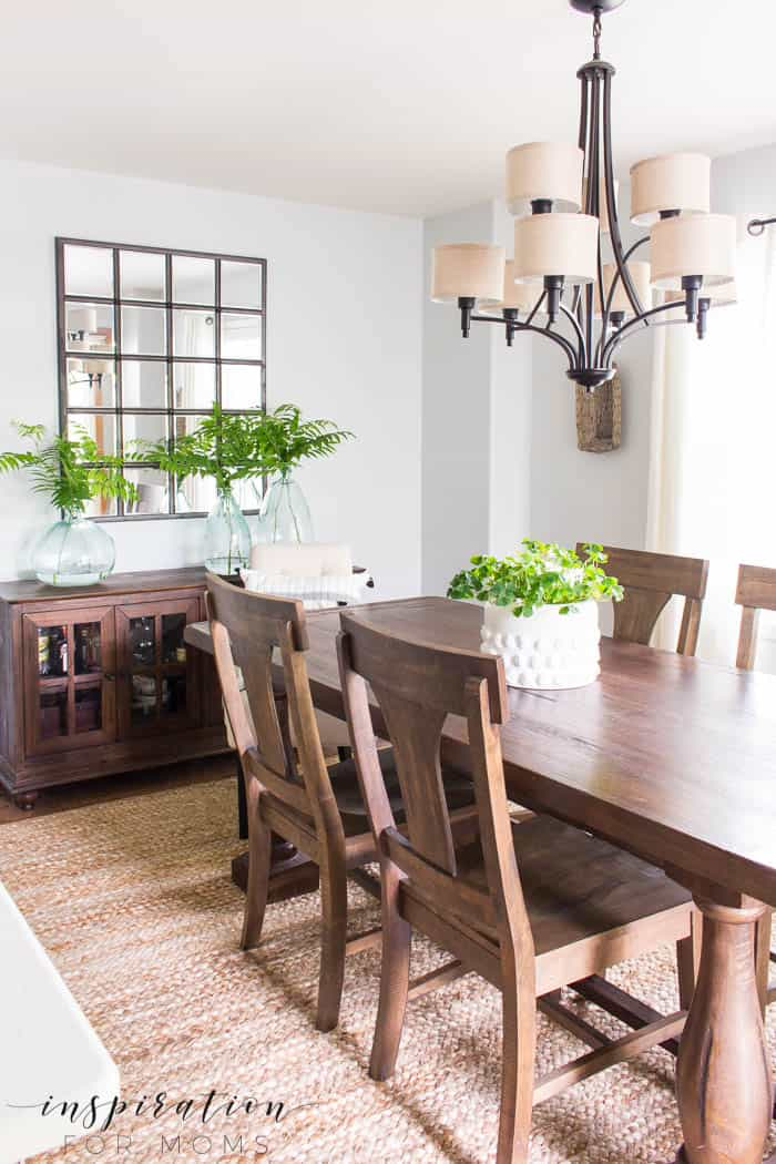 simple summer dining room decor with rustic farmhouse table and green plants