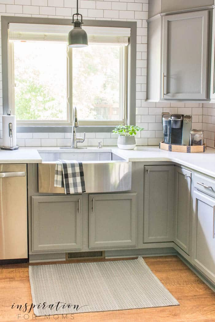 simple summer kitchen decor with farmhouse sink and gray cabinets subway tile