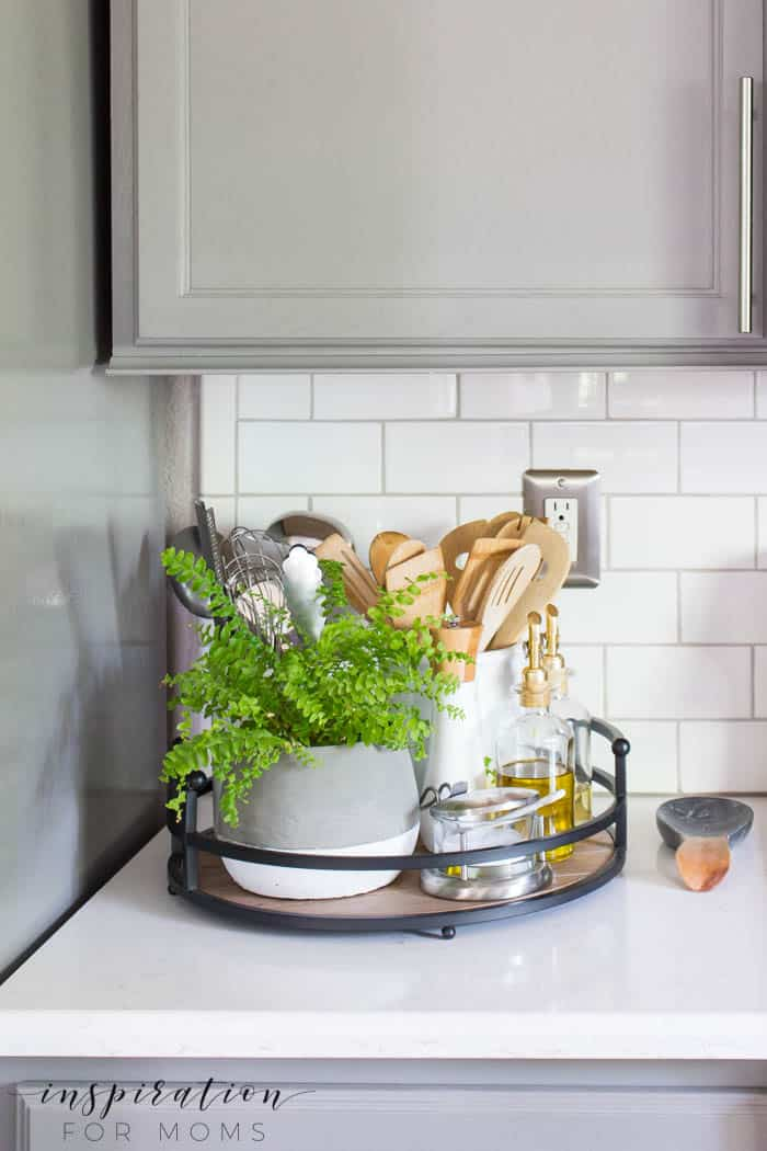 simple summer kitchen decor with wood tray and gray cabinets subway tile