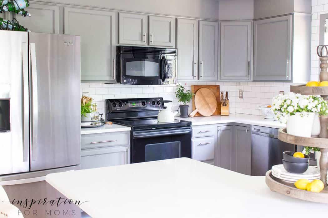 summer home tour kitchen gray cabinets white subway tile farmhouse sink