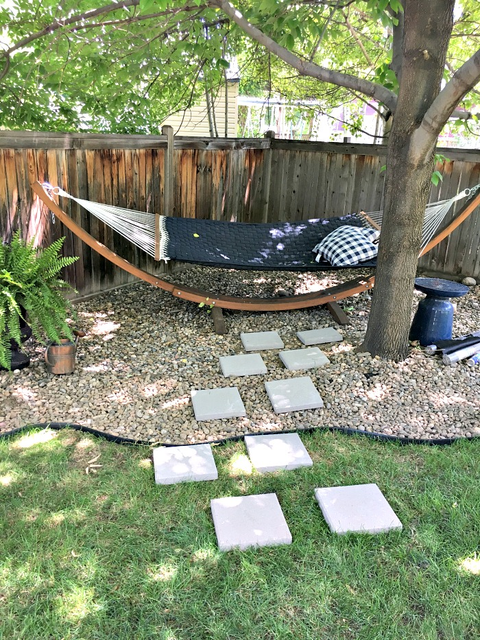 Create a beautiful new look for your backyard by adding a simple diy paver stone path and some new landscape edging. This easy tutorial explains it all!