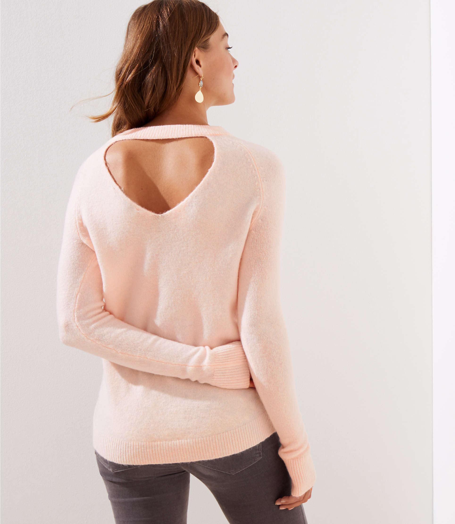 Love this sweater with the pretty back detail. Great for messy bun days!