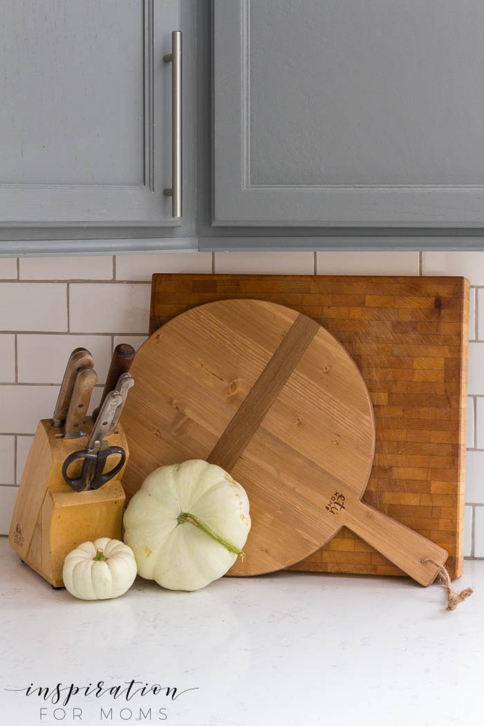Enjoy a kitchen and dining room fall home tour full of lovely neutral colors like white pumpkins, green eucalyptus and purple mums.