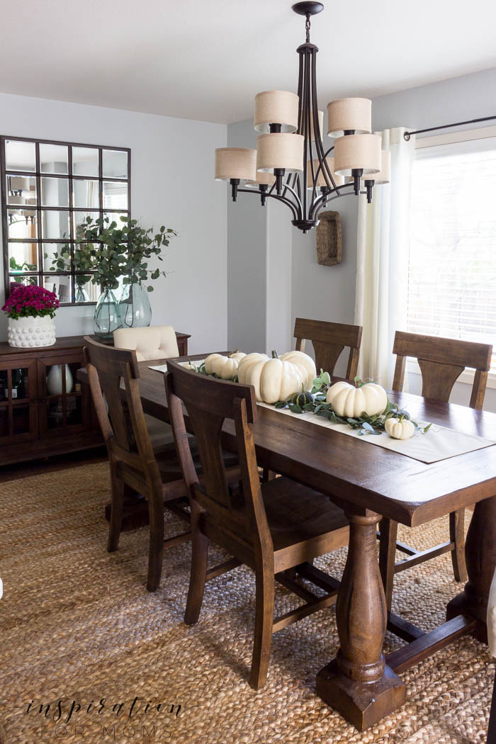 Enjoy a kitchen and dining room fall home tour full of lovely neutral colors like white pumpkins and green eucalyptus.