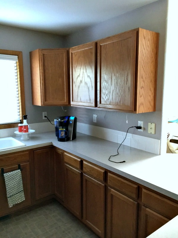Updating kitchen cabinet doors doesn't have to be time consuming or expensive. Heck, you don't even need any tools!