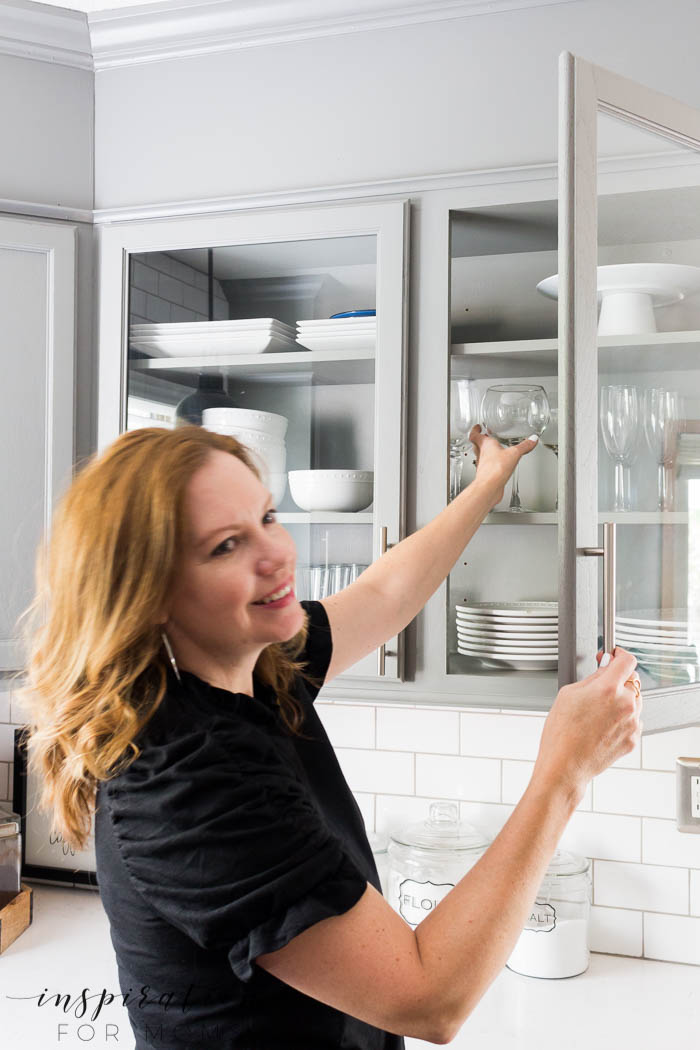 Updating kitchen cabinet doors doesn't have to be time consuming or expensive. Heck, you don't even need any tools for this tutorial!