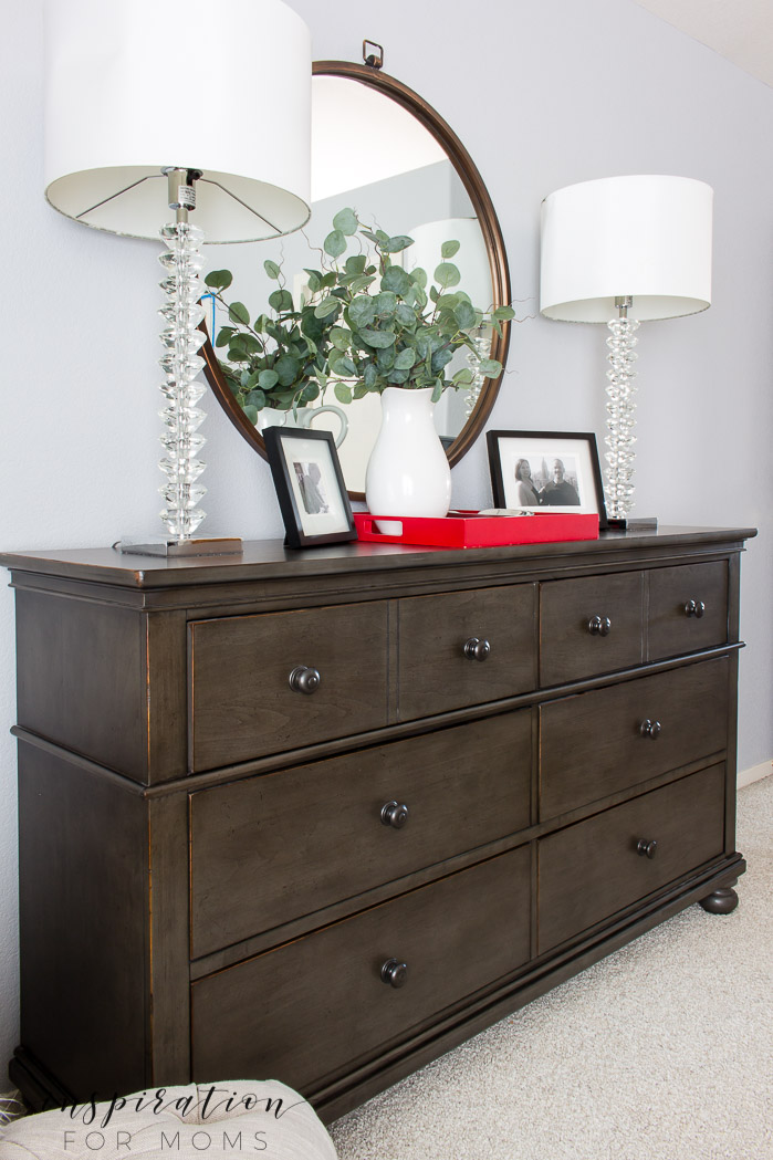 Simple red and grey decor adds soft touches of holiday style to this Christmas Master Bedroom.