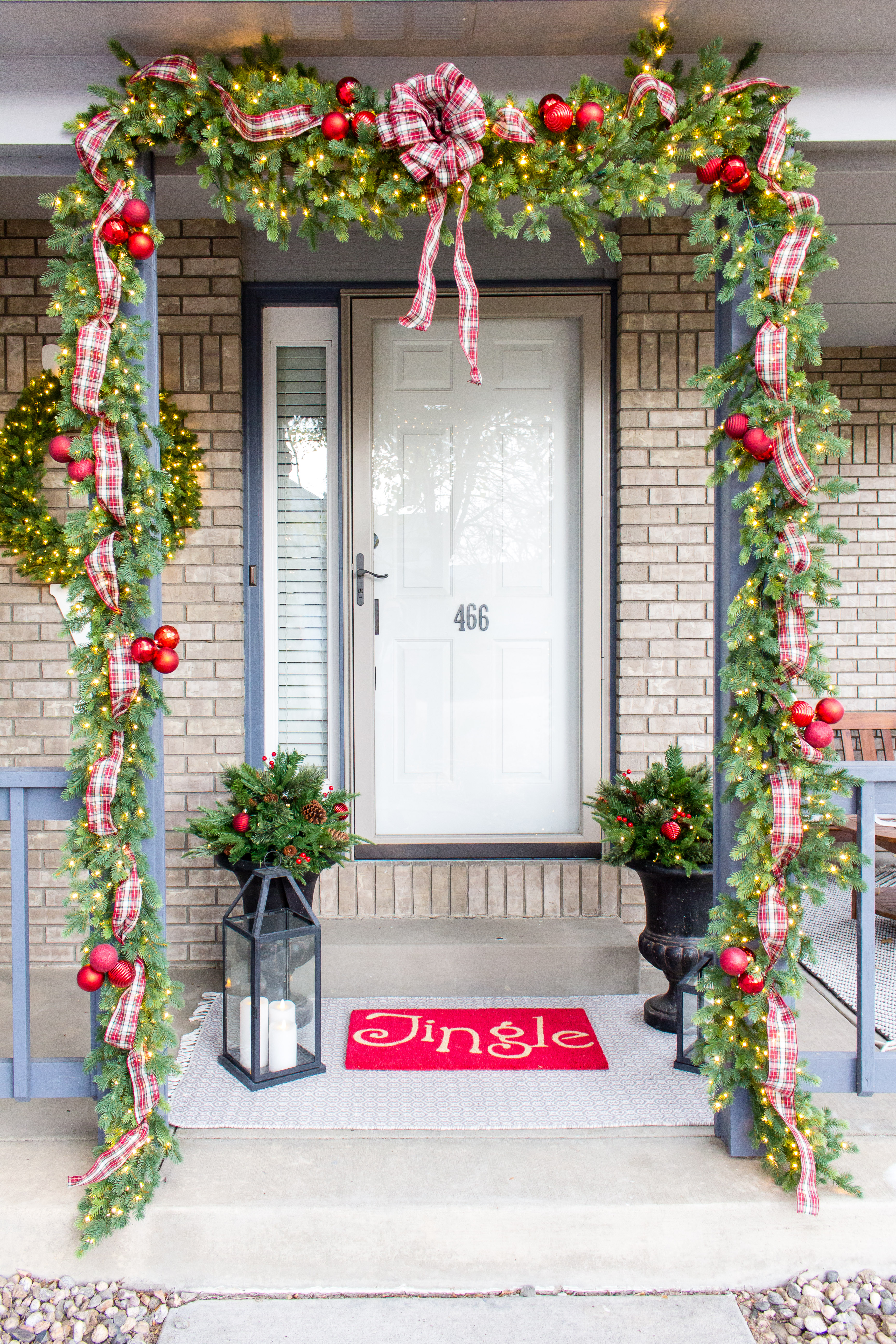 Looking for ideas on how to add Christmas cheer to your front door for the holidays? I have a ton of tips!
