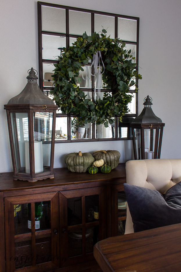 thanksgiving tablescape with eucalyptus wreath on mirror and pumpkins