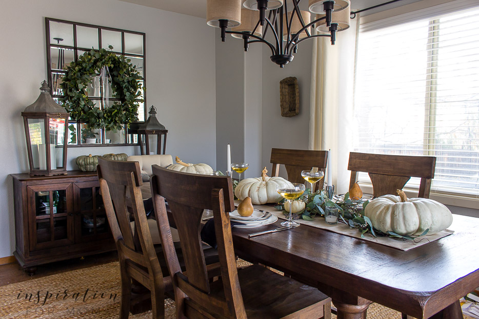 thanksgiving tablescape dining room with white pumpkins and eucalyptus