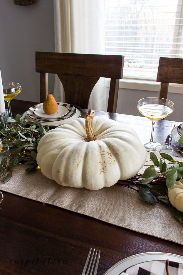 thanksgiving tablescape with white pumpkins and eucalyptus