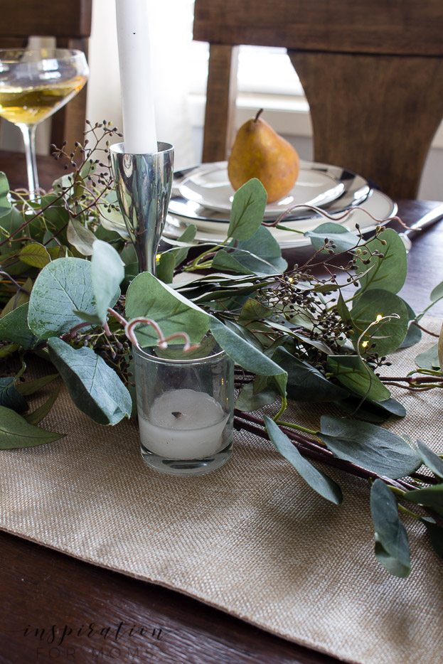 thanksgiving tablescape with eucalyptus and tealight candles and pear