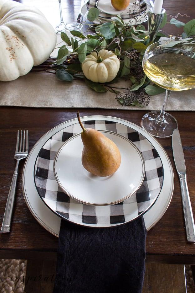 thanksgiving tablescape with white pumpkins, eucalyptus and buffalo check plates