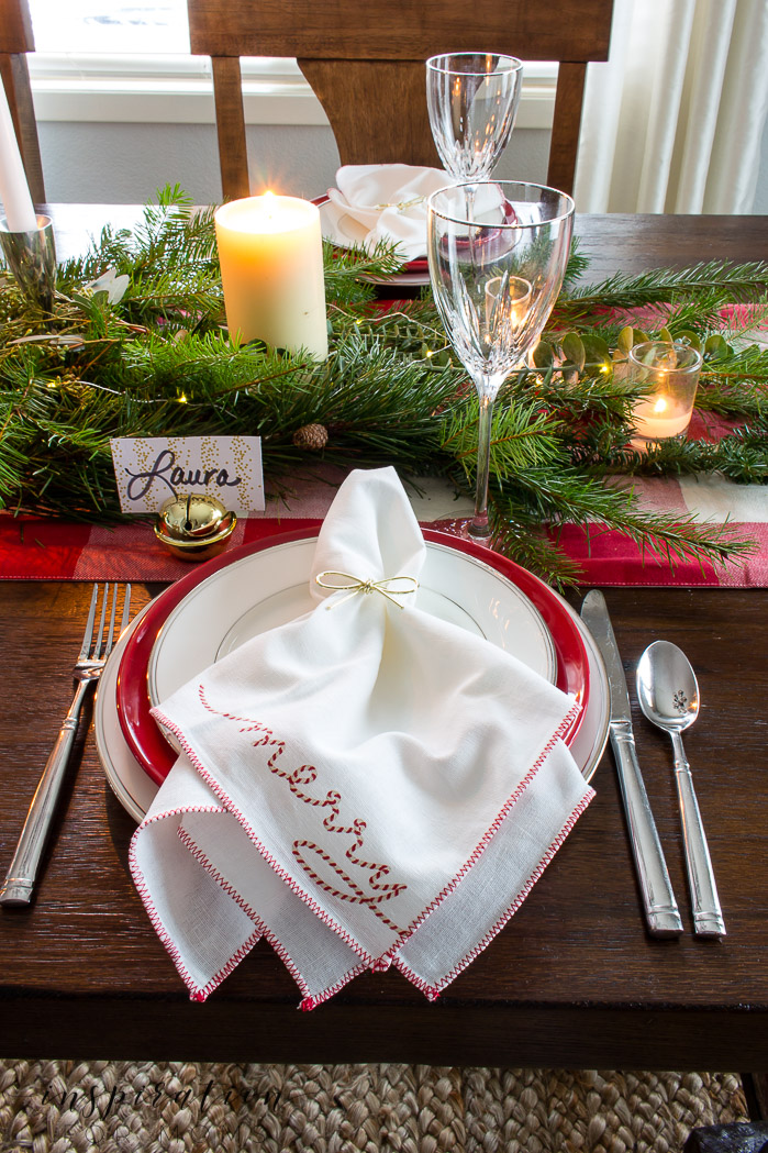 Enjoy a beautiful Christmas Home Tour full of neutral decor & pops of traditional red. See a tour of the porch, kitchen, dining room & master bedroom.