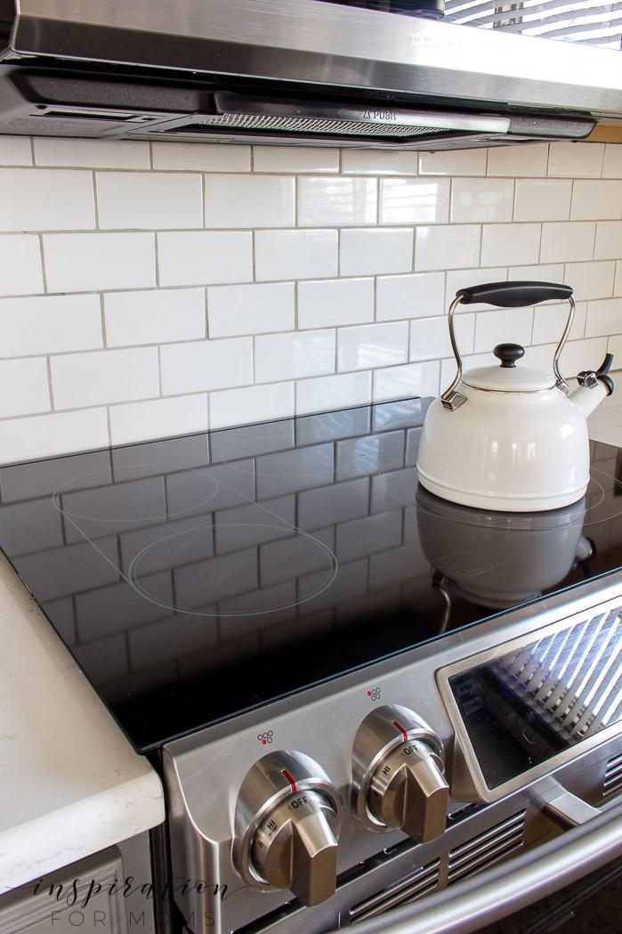clean kitchen range with white subway tile