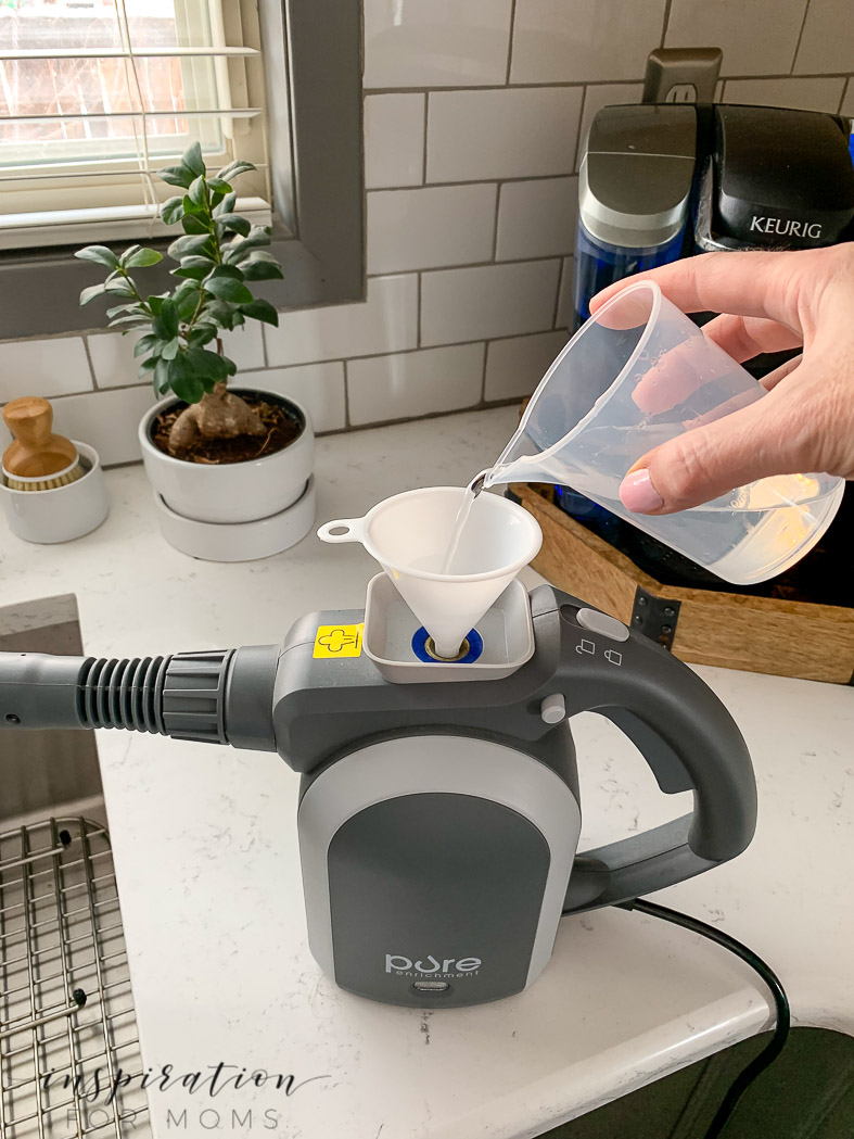 hand held steamer used to clean kitchen fast