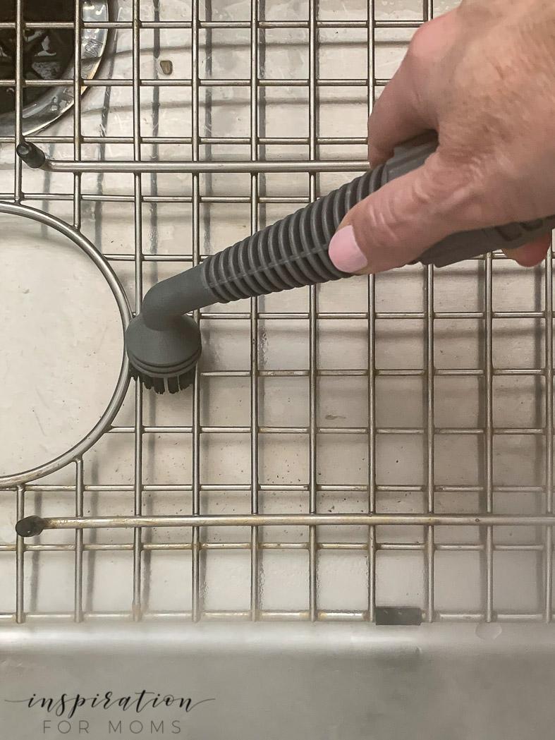 clean kitchen metal sink grid