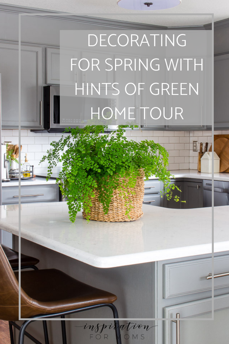 Decorating with hints of green is easy to do with the help of fresh flowers and pretty plants. #springdecor #hometour #modernkitchen #subwaytile