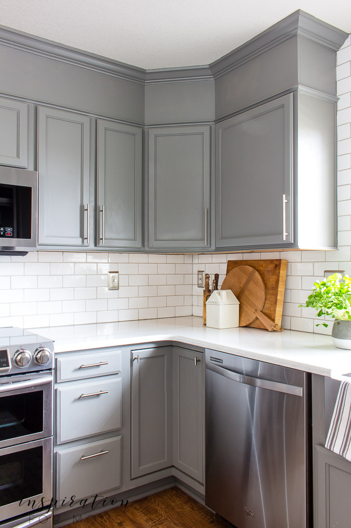 Decorating with hints of green is easy to do with the help of fresh flowers and pretty plants. white subway tile, Quartz counters modern kitchen